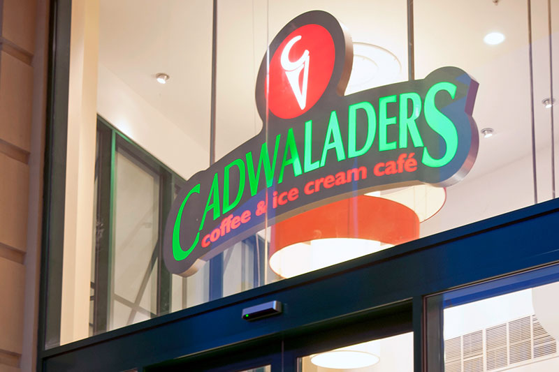 Cadwaladers illuminated window sign